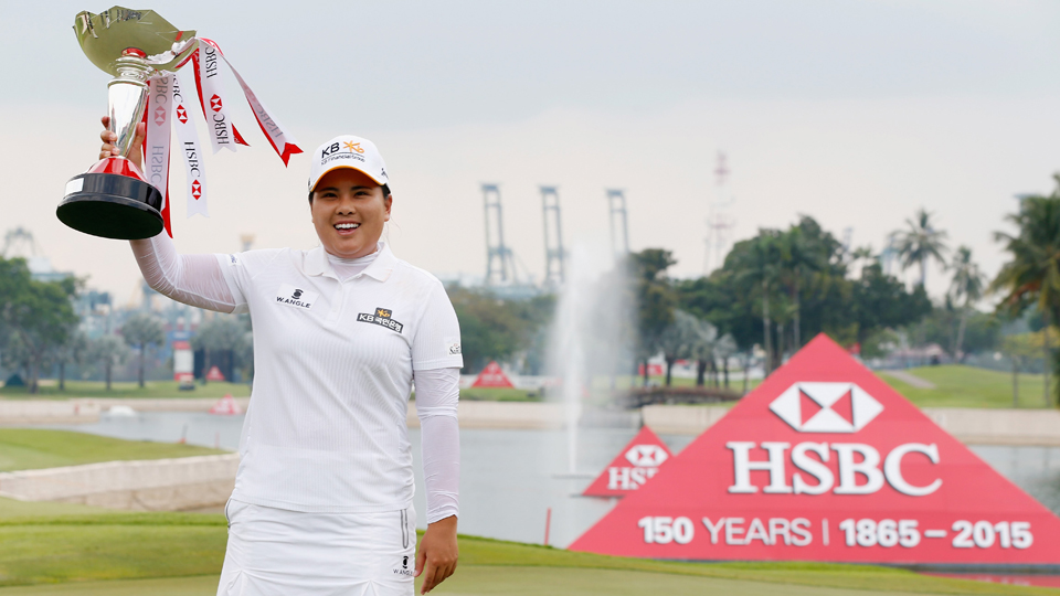 Inbee Park poses with the trophy on the 18th green after her two-stroke victory at the HSBC Women's Champions.