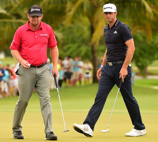 J.B. Holmes (left) is long by any standard, but he couldn't keep pace with Johnson.