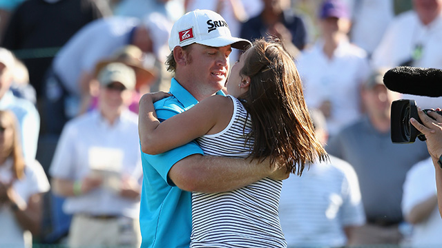 J.B. Holmes celebrates victory with his wife Erica after holing the winning putt during the final round of the 2014 Wells Fargo Championship, his first PGA Tour win after undergoing brain surgery.