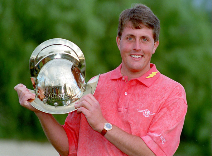 Phil Mickelson stands with the helmet trophy after winning the 1991 Northern Telecom Open in Tucson, Arizona.
