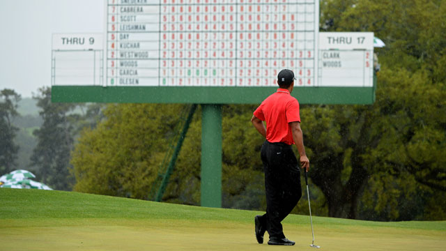 Tiger Woods looks at the leaderboard during the 2013 Masters, his last event at Augusta National.