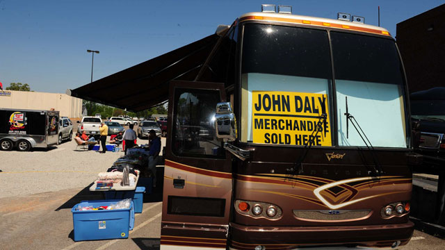 If you can't make it inside the gates, you're in luck. John Daly is offering signed merchandise across the street.
