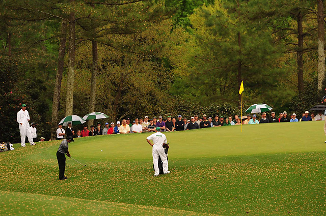 Tiger Woods chips onto the 10th green at the 2010 Masters.