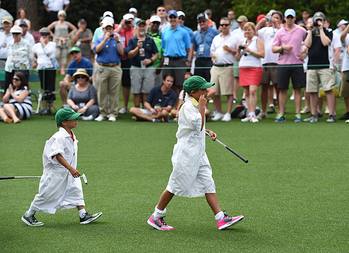 Tiger Woods' two children, Sam (right) and Charlie, put on the white Masters bibs to caddie for their Dad during the Par-3 contest.
