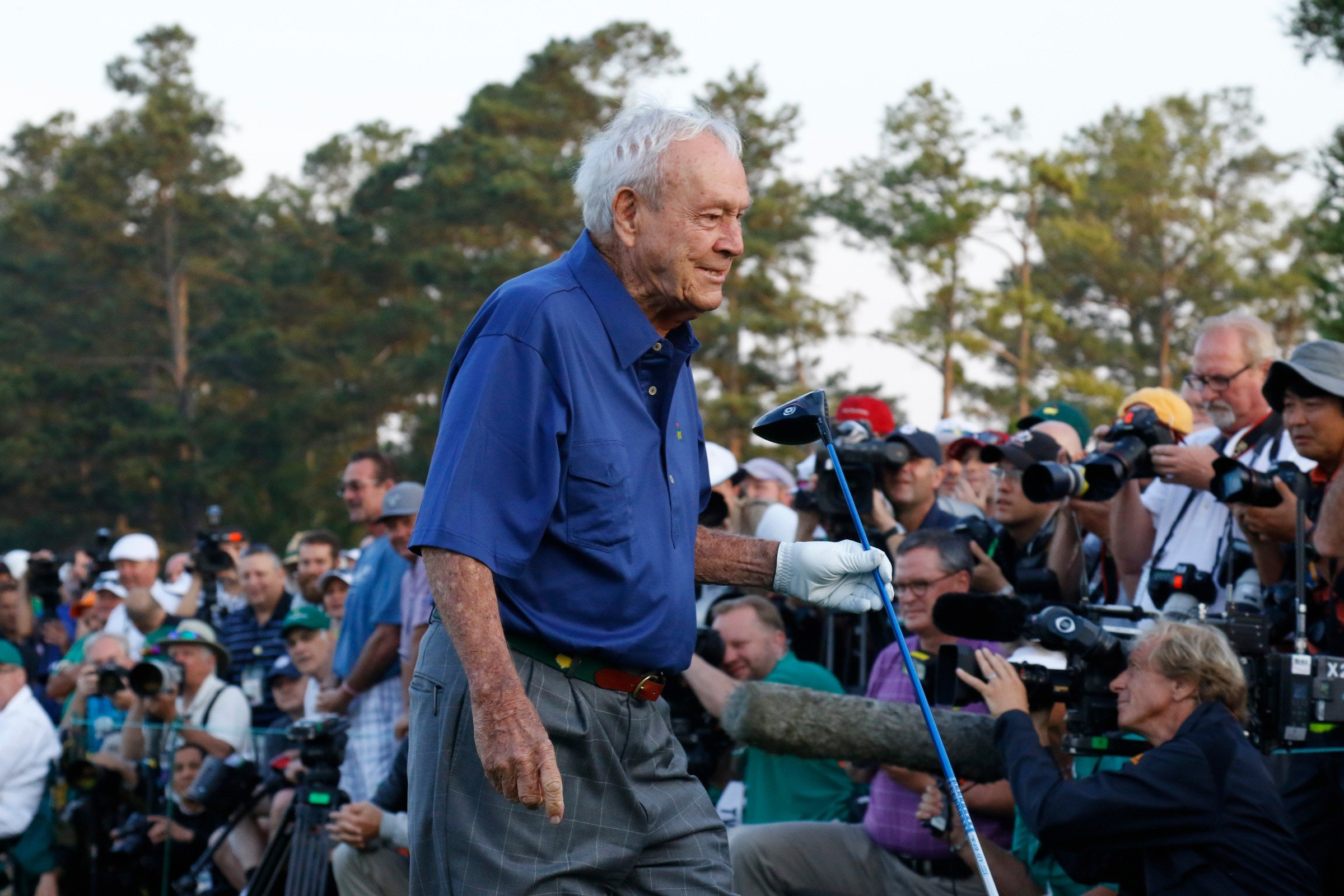 Arnold Palmer after hitting his tee shot. Palmer missed Wednesday's Par 3 Contest because of a shoulder injury.