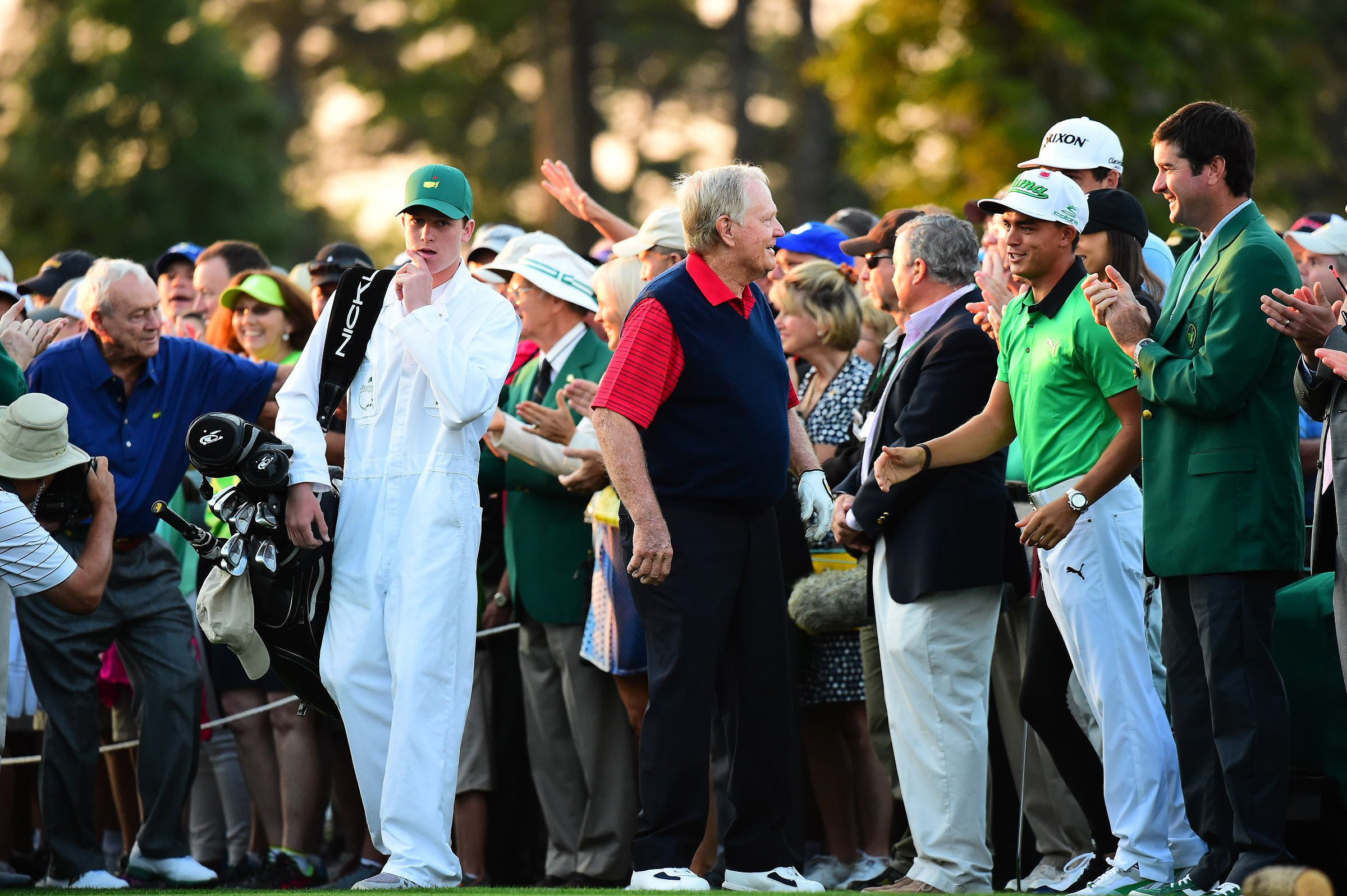 "Jack Nicklaus says ""hi"" to Rickie Fowler and Bubba Watson when he arrives on the first tee at Augusta National."
