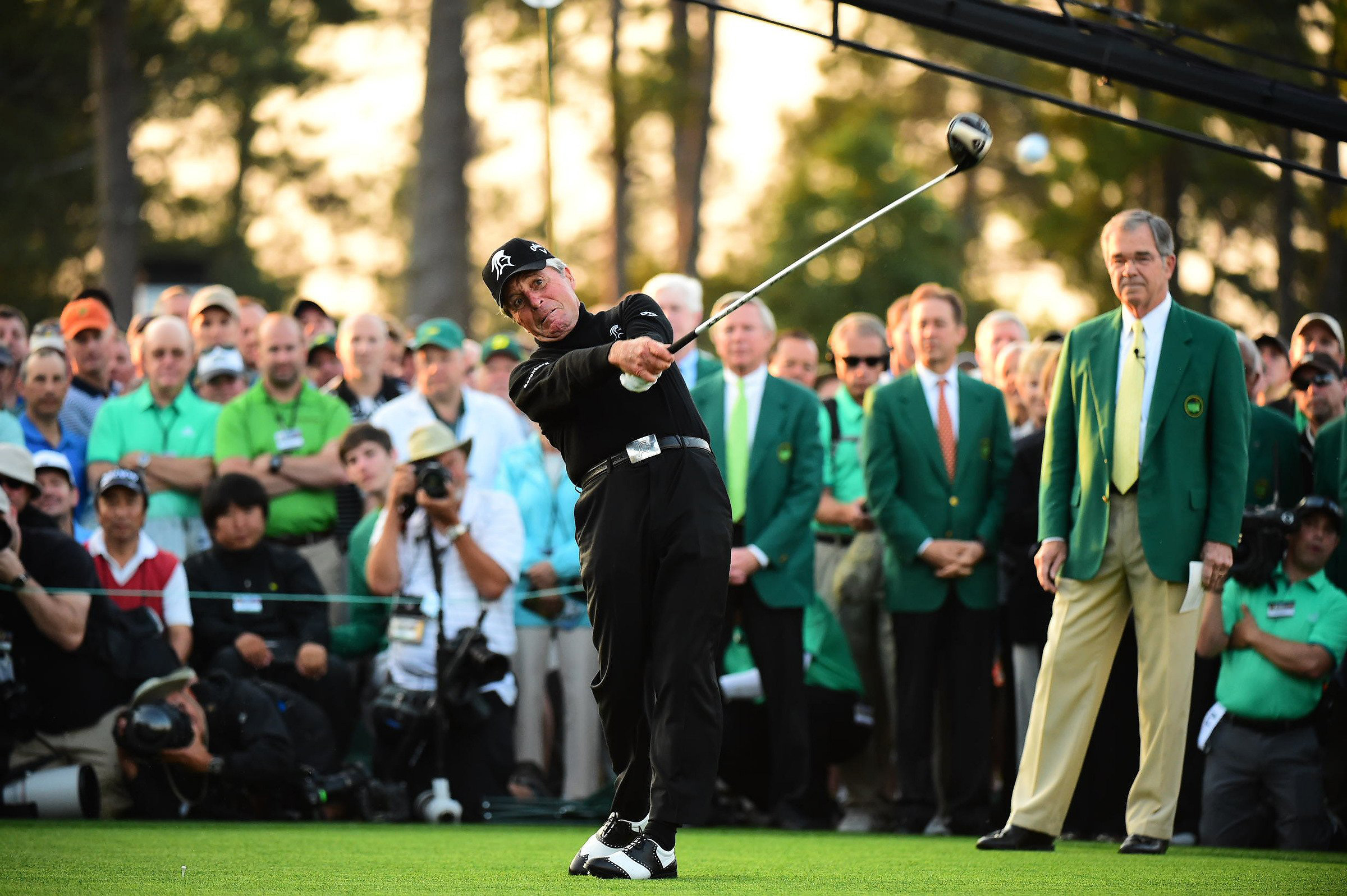 Gary Player takes a healthy swing on his ceremonial tee shot Thursday morning.