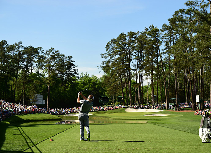 Russell Henley tees off on the par-3 16th hole at Augusta.