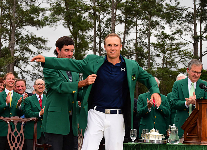 Bubba Watson helps Spieth into his green jacket.