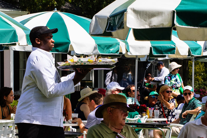A waiter on Saturday at the 2015 Masters.