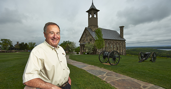 "ONE MAN'S VISION: Morris, outside the chapel, says Top of the Rock is ""like a beautiful garden on a hilltop, and the golf course gives you a way to walk around it."""