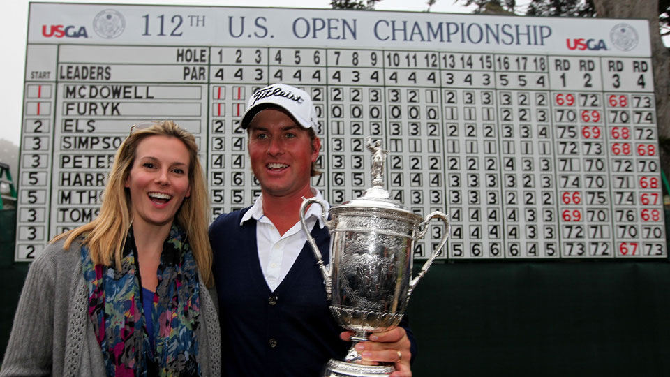 Webb and Dowd Simpson pose in front of the scoreboard at the 2012 U.S. Open.