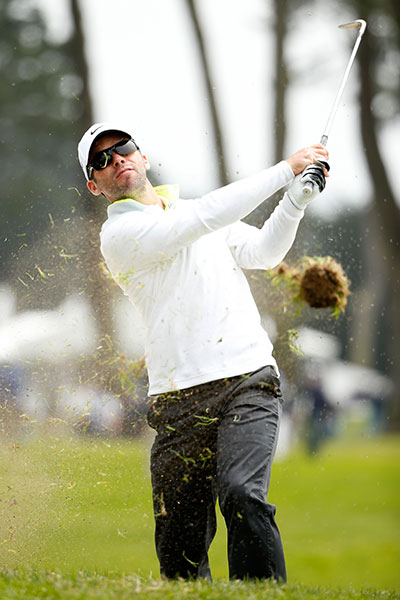 Paul Casey takes a huge divot en route to winning 3 & 1 over Charl Schwartzel.
