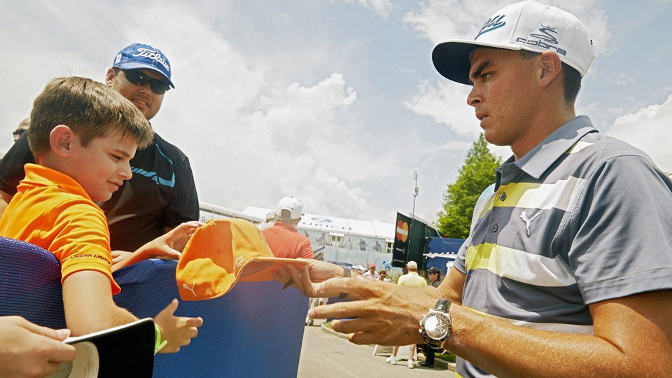 In New Orleans, Fowler stopped to sign a hat for one of his countless young followers.