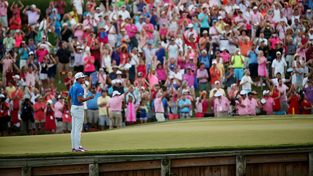 Rickie Fowler celebrates winning the Players Championship on the 17th hole at TPC Sawgrass.