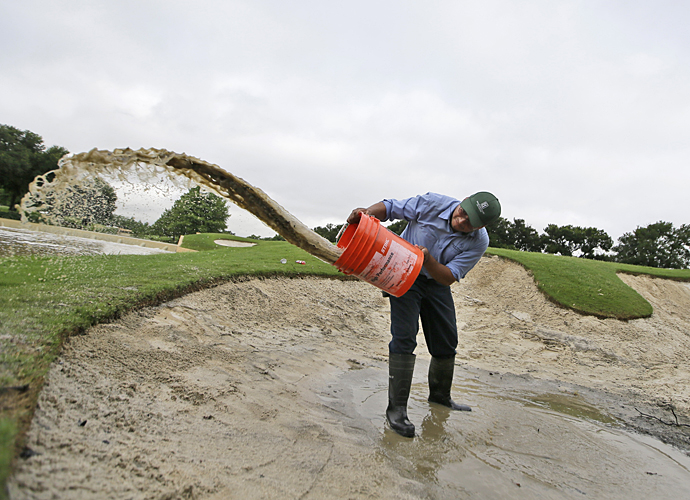 Rain pummeled the course Friday morning at the AT&T Byron Nelson, causing a three-hour rain delay.