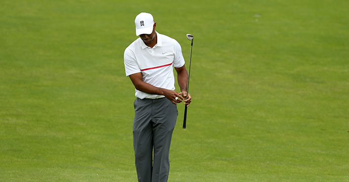 Tiger Woods reacts to his third shot on the 18th hole during the third round of The Memorial Tournament presented by Nationwide at Muirfield Village Golf Club on June 6, 2015 in Dublin, Ohio.