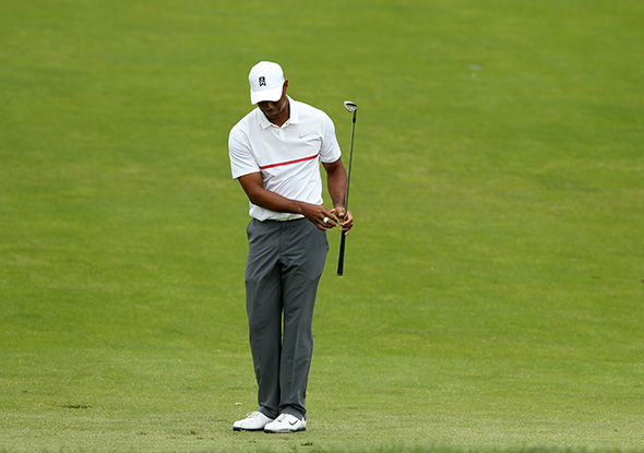 Tiger Woods reacts to his third shot on the 18th hole during the third round of The Memorial Tournament.