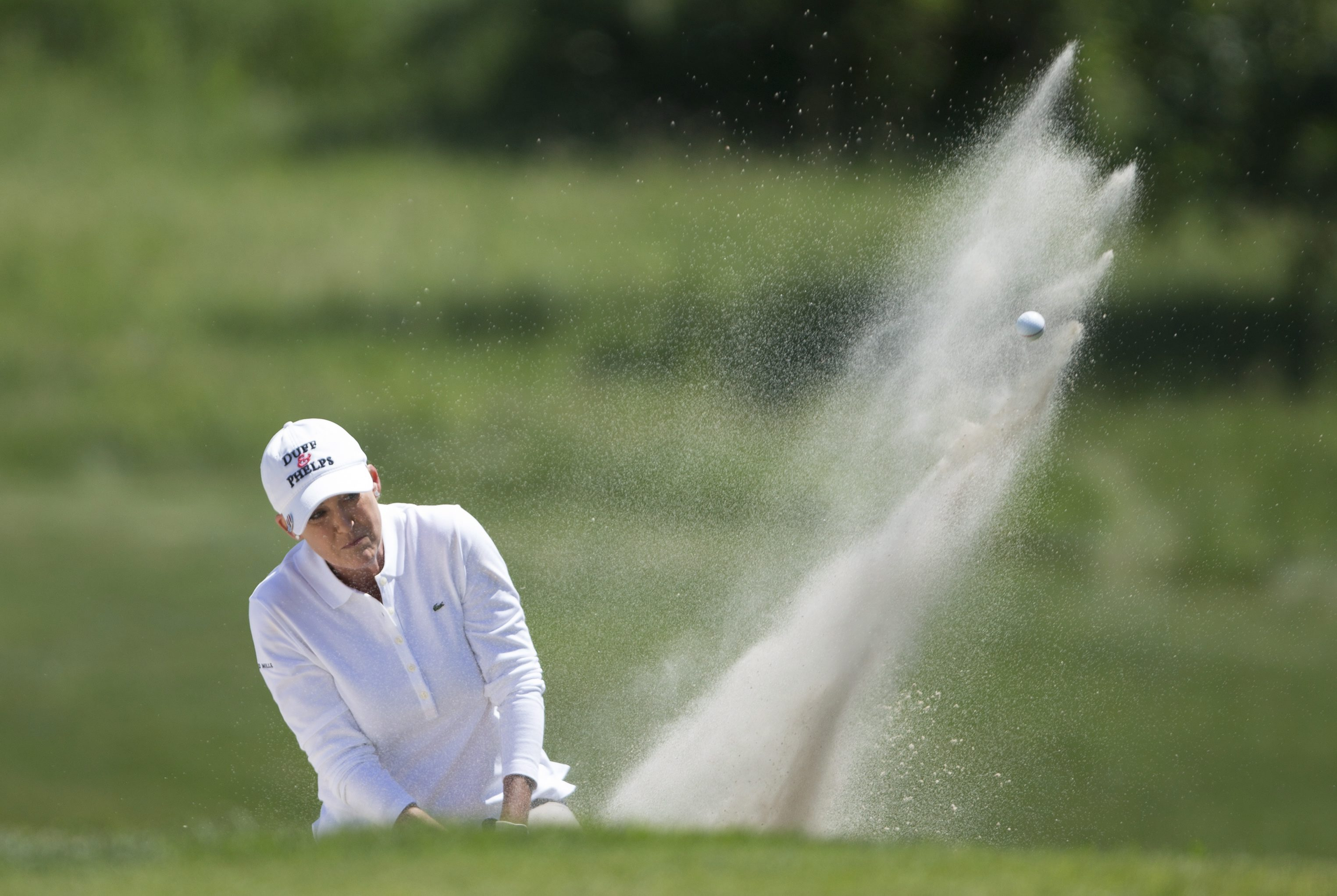 Cristie Kerr, of the United States blasts out of the sand on the third hole during the third round of the 2015 Manulife LPGA Classic, Saturday, June 6, 2015 in Cambridge, Ontario. (Peter Power/The Canadian Press via AP) MANDATORY