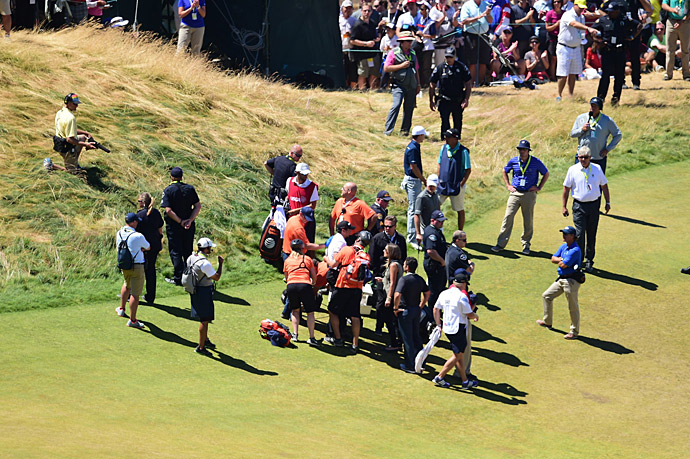Medical personnel tended to Day in the fairway.