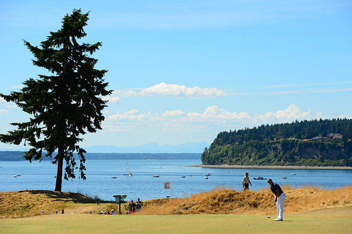 Jordan Spieth putts on Sunday with Puget Sound in the background.