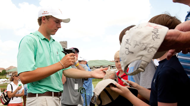 Jordan Spieth signs autographs after the second round of the 2010 HP Byron Nelson Championship.