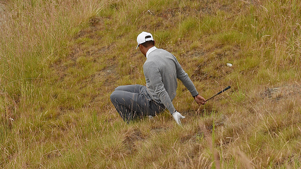Tiger Woods slips and falls near the 10th green during round 2 of the 2015 U.S. Open.