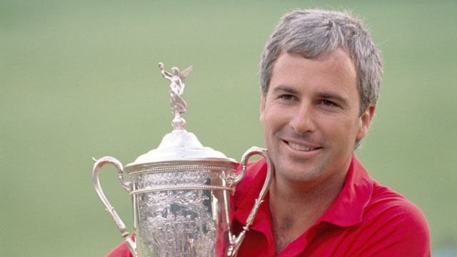 Curtis Strange of the United States hugs the trophy after winning the US Open Golf Championship held at the Oak Hill Country Club in New York.