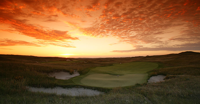 The sunrise from behind the green on the 367 yard par-4 8th of the Sand Hills Golf Club in Mullen, Nebraska.