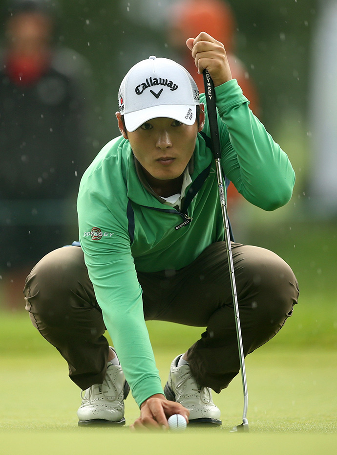 Danny Lee of New Zealand prepares to putt on the 11th hole during the second round of the Greenbrier Classic.