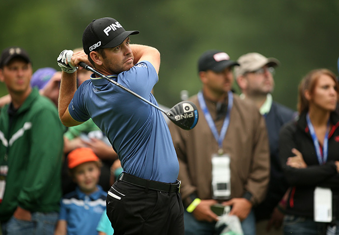 Louis Oosthuizen of South Africa tees off on the 12th hole during the second round of the Greenbrier Classic.