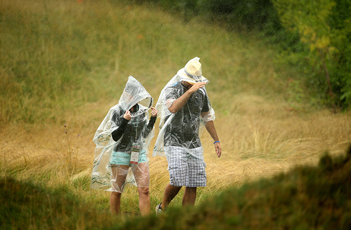 Patrons walk along the course in the rain during the second round of the Greenbrier Classic.