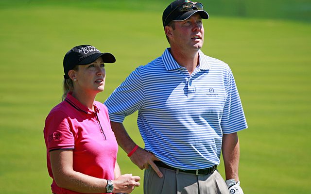 Mike Whan with LPGA pro Cristie Kerr during the Birdies for Breast Cancer Foundation Liberty Cup at Liberty National Golf Club.