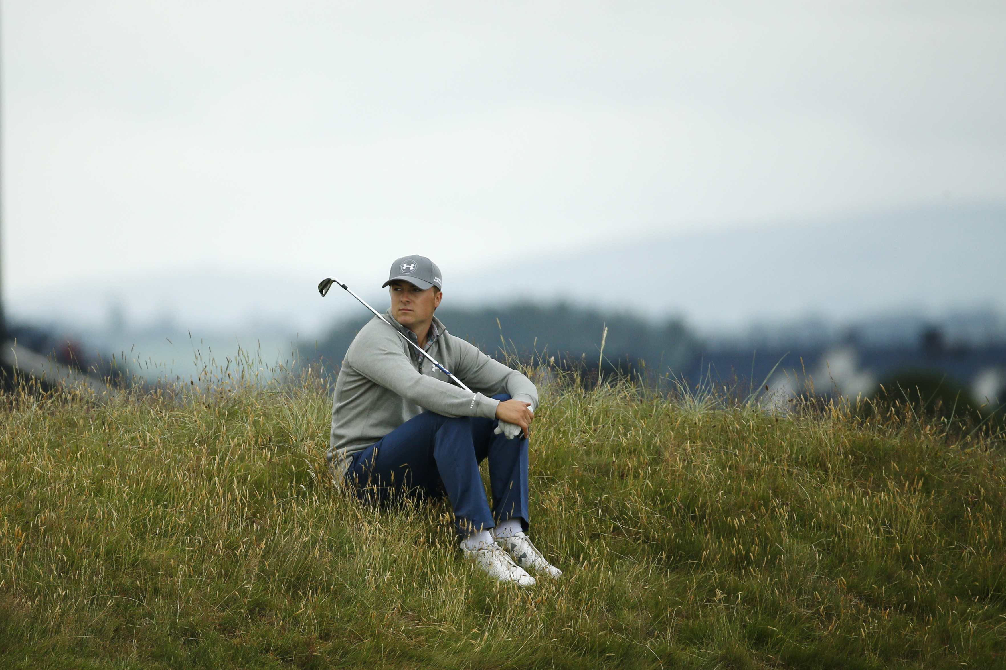 United States' Jordan Spieth sits in the rough on hole four during a practice round at the British Open Golf Championship at the Old Course, St. Andrews, Scotland, Tuesday, July 14, 2015. (AP Photo/Jon