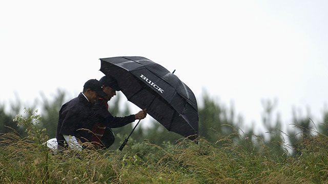Tiger Woods walks with caddie Steve Williams to the fifth hole during the third round of the 131st Open Championships at Muirfield Golf Club, Gullane, Scotland on July 20, 2002.