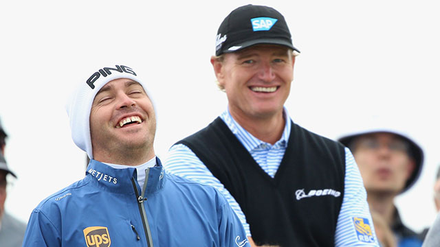 Louis Oosthuizen shares a laugh with Ernie Els during a practice round on Tuesday.