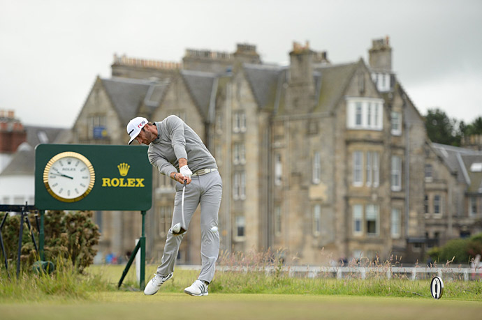 Dustin Johnson overpowered the Old Course Thursday on his way to an opening-round seven-under 65 and the early lead.