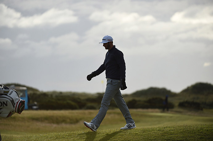 Dustin Johnson reach 10 under, good enough for a one-shot lead heading into the third round.