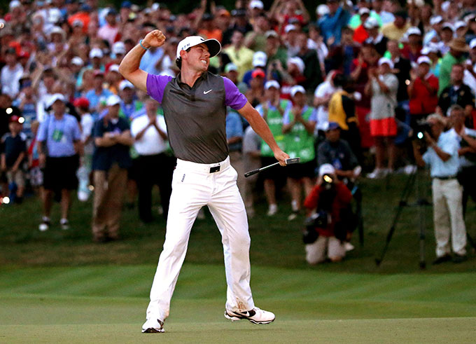 Rory McIlroy of Northern Ireland celebrates his one-stroke victory on the 18th green during the final round of the 96th PGA Championship at Valhalla Golf Club on August 10, 2014 in Louisville, Kentucky
