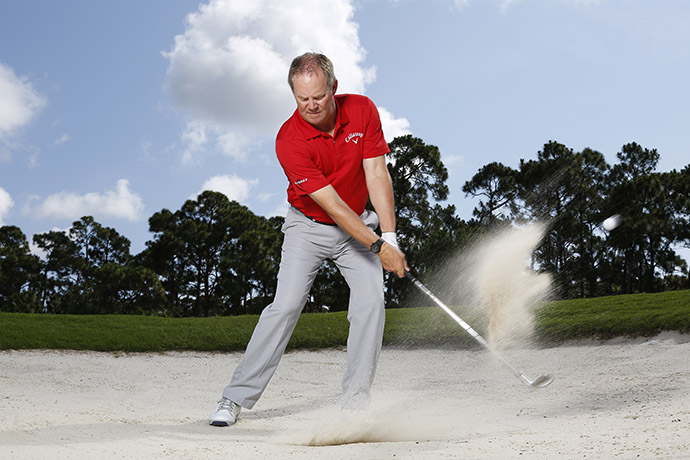 Standard bunker swing - allow your forearms to roll going back and coming through.