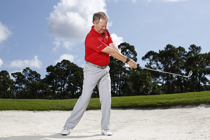 Stop your swing abruptly after impact.