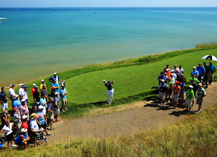 Justin Rose hits a recovery shot at Whistling Straits.