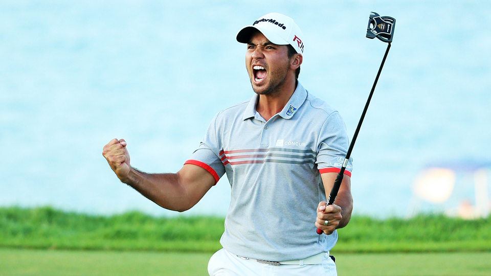 Jason Day reacts after sinking a putt on the 17th green during the third round of the PGA Championship at Whistling Straits on Aug. 15, 2015, in Haven, Wisconsin. Day leads Jordan Spieth by two after three rounds.