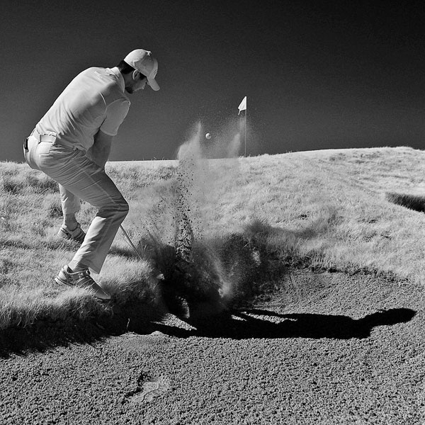 Jason Day blasts out of a bunker at Whistling Straits.