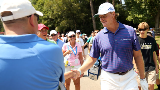 Ernie Els greets fans at the 2014 Wyndham Championship at Sedgefield Country Club.
