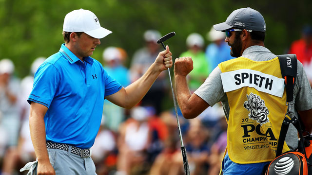 Jordan Spieth of the United States celebrates a birdie with his caddie Mike Greller on the sixth hole during the final round of the 2015 PGA Championship at Whistling Straits on August 16, 2015 in Sheboygan, Wisconsin.