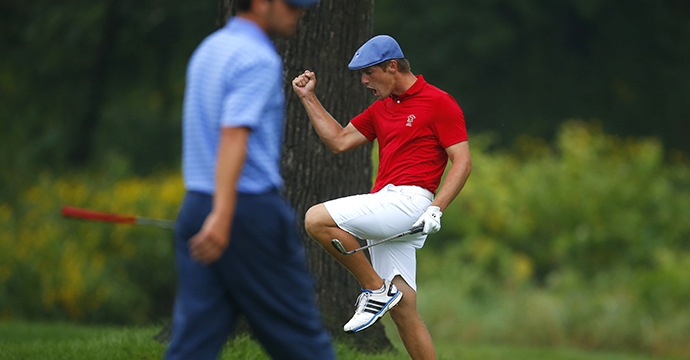 Bryson DeChambeau (R) reacts to chipping in on the eighth hole as Derek Bard (L) watches during the final match of the 2015 U.S. Amateur Championship.