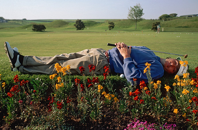 David Feherty takes time to catch some rest between rounds of golf, circa 1993.