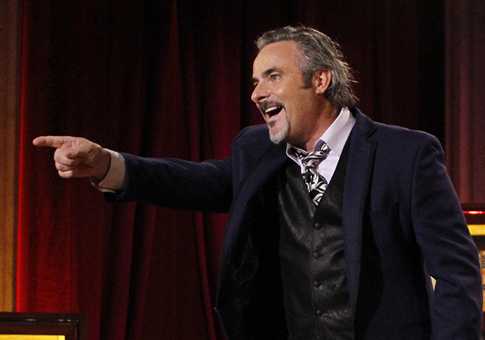 "Host David Feherty speaks onstage during ""Feherty Live!"" at the Orpheum Theatre, Phoenix, Arizona"