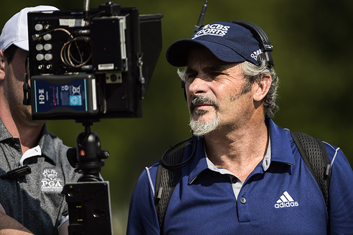 David Feherty broadcasts live coverage for CBS Sports during the third round of The Barclays at Plainfield Country Club on August 29, 2015.